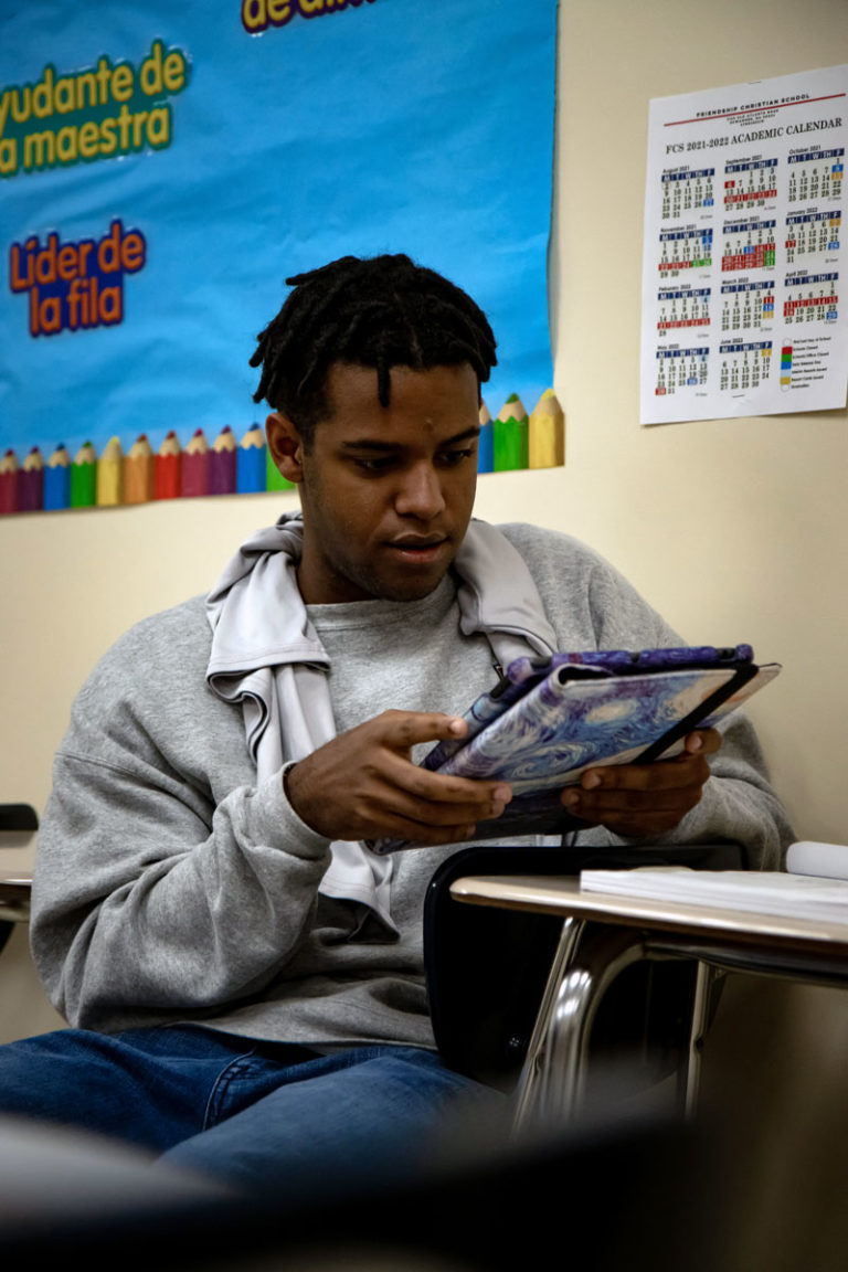 student using a tablet at Christian School